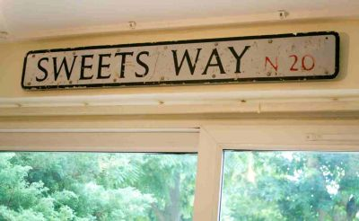 Sweets Way Sign in Living Room